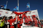Team Penske gives Ryan Briscoe a lift after his win at Milwaukee