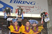 Timo Bernhard, Romain Dumas and Emmanuel Collard celebrate the team's overall win at Sebring